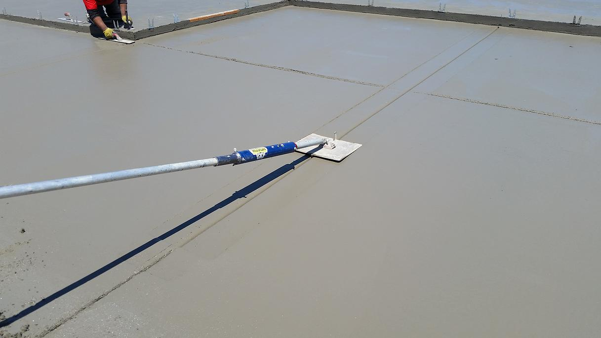 how to slick finish concrete