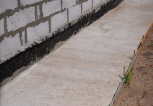 Waterproofing and vapor barrier on concrete foundation